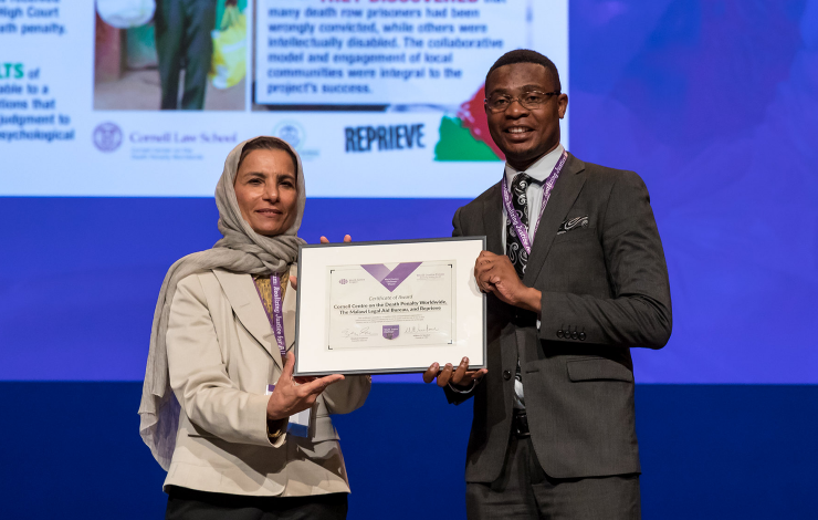A rep from the Malawi Resentencing Project accepts one of five 2019 World Justice Challenge awards.